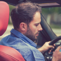 Male driver distracted