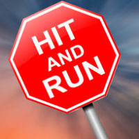 red sign that reads hit and run