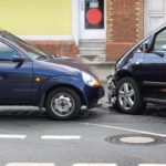 head-on car crash with damage at front of cars
