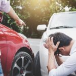 Two drivers man arguing after a car traffic accident collision, Traffic Accident and insurance concept